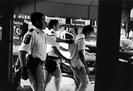 A common sight: Police arrest a man off the street in the middle of the Coahuila red light district, Zona Norte, Tijuana, Mexico.  There is an extremely heavy police presence in the red light district by a police force that lord over the Paraditas.