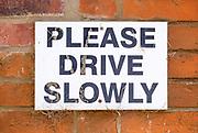 Macro close up sign Please Drive Slowly, UK