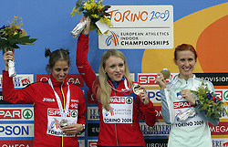 Second placed Natalia Rodriguez of Spain, winner and european champion Anna Alminova of Russia and Third placed Sonja Roman of Slovenia at the podium after the final race of 1500m women at the 2nd day of  European Athletics Indoor Championships Torino 2009 (6th - 8th March), at Oval Lingotto Stadium,  Torino, Italy, on March 6, 2009. (Photo by Vid Ponikvar / Sportida)
