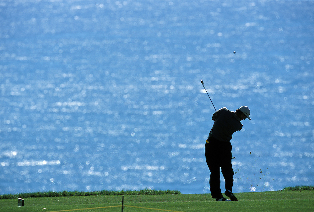 Golfers at Torrey Pines Municipal golf course in San Diego, CA enjoy a majestic view of the Pacific Ocean while teeing off on a spring morning.