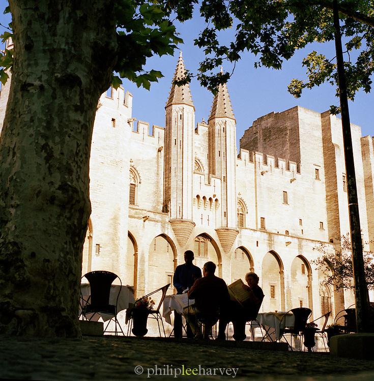 A cafe terrace in front f the Palais des Papes, Avignon, France