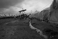 Newly arrived refugees from Idlib province erect their tents and use the washing facilities. Over the past week more than 1000 refugees have crossed into Turkey to escape renewed targetting of Syria's north western provinces, a year since the start of the uprising. March 14th 2012, Reyhanli, Hatay, Turkey.