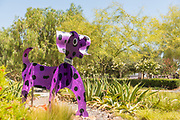 Purple Spotted Dog Sculpture at La Paws Dog Park