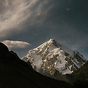 Moonlight, night shot of Baba Tangi (6513m). The traditional life of the Wakhi people, in the Wakhan corridor, amongst the Pamir mountains.