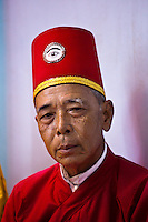 Cao Dai preist wearing red to signify authority and represent the Confucianist aspects of Cao Dai.