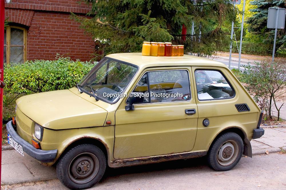 A mobile kiosk selling Polish honey from car top.  Spala   Poland