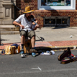 York, PA / USA - May 8, 2016: A man plays a fiddle at the annual Mother's Day Fair.