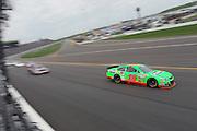 Danica Patrick (10) and other drivers during a NASCAR Sprint Cup race at Kansas Speedway, Sunday, April 21, 2013 in Kansas City, Kansas. (AP Photo/Colin E. Braley)