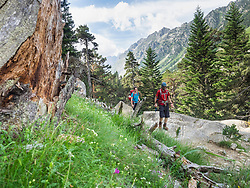 Man and woman hiking in the High Pyrenees near Cauterets, France