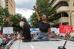 Josh and Angelica Bias protest from their car in Atlanta, GA, USA on Friday, May 29, 2020, amid outrage over the death of George Floyd in Minneapolis. Photo by Alyssa Pointer/Atlanta Journal Constitution/TNS/ABACAPRESS.COM
