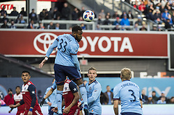 April 29, 2018 - Bronx, New York, United States - New York City defender SEBASTIEN IBEAGHA (33) heads the ball away from goal while New York City defender ANTON TINNERHOLM (3) looks on during a regular season match at Yankee Stadium in Bronx, NY.  NYCFC defeats FC Dallas 3 to 1. (Credit Image: © Mark Smith via ZUMA Wire)