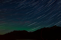 Night Sky, Star Trails, and Northern Lights looking northeast from Haines, Alaska. Composite of images from 02:00 to 02:29 taken with a Nikon D3x camera and 45 mm f/2.8 PC-E lens (ISO 400, 45 mm, f/5.6, 29 sec). Raw images processed with Capture One Pro and the composite generated using Photoshop CC (statistics, maximum).