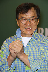"""Jackie Chan signs copies of his new book, """"Never Grow Up"""" at Barnes & Noble in New York City."""