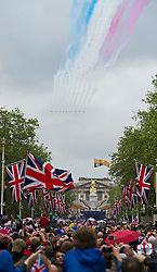 © London News Pictures. 05/06/2012. London, UK.  The Red Arrows perform a flypast over Buckingham Palace on June 5, 2012 as part of the Diamond Jubilee celebrations.  Photo credit: Ben Cawthra/LNP