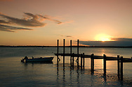 A dock at sunset in Dunmore Town, Harbour Island, Eleuthera, The Bahamas