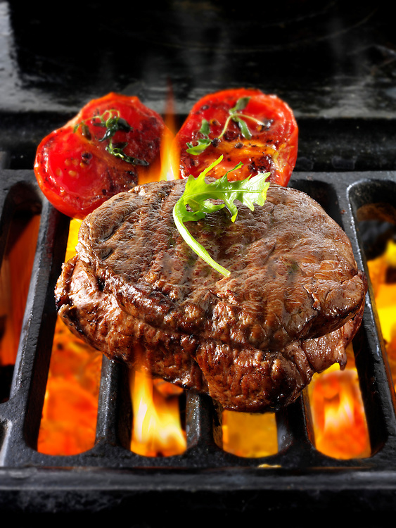 Beef fillet steaks & tomatoes being cooked on a bbq. Meat food photos, pictures & images.