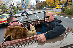 Max Herman and Aki Sakamoto in a '32 Roadster on a ride around Tokyo with friends of the Freewheelers And Company shop. Tokyo, Japan. December 8, 2015.  Photography ©2015 Michael Lichter.