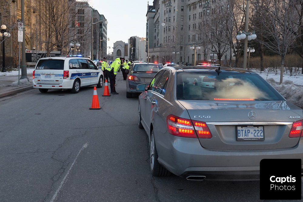 Ottawa Police, partnered with Ontario Provincial Police and Military Police look for impaired drivers on St.Patrick's Day at a R.I.D.E. checkpoint on MacKenzie Avenue in Ottawa. March 17, 2015.