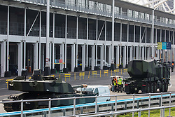 Armed military vehicles are pictured in a holding area outside ExCeL London as preparations for the DSEI 2021 arms fair take place on 6th September 2021 in London, United Kingdom. The first day of week-long Stop The Arms Fair protests outside the venue for one of the world's largest arms fairs was hosted by activists calling for a ban on UK arms exports to Israel.