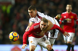 Manchester United's Luke Shaw (left) and Burnley's Sam Vokes (right) battle for the ball
