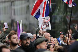 © Licensed to London News Pictures. 23/10/2018. London, UK. Supporters of former English Defence League leader Tommy Robinson await his arrival outside the Old Bailey in London, where he is accused of contempt of court for breaking reporting restrictions around the Huddersfield grooming gang trial.  Photo credit: Rob Pinney/LNP