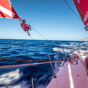 Leg 02, Lisbon to Cape Town, day 13, on board MAPFRE, Sophie Ciszek putting a rope to gybe. Photo by Ugo Fonolla/Volvo Ocean Race. 17 November, 2017