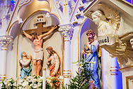 """A statue depicting an angel with the word """"Immanuel,"""" seen against the statue depicting Jesus Christ, on Monday, April 5, 2021, at Immanuel Lutheran Church, St. Charles, Mo. LCMS Communications/Erik M. Lunsford"""
