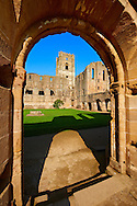 Entrance to central courtyard of Fountains Abbey , founded in 1132, is one of the largest and best preserved ruined Cistercian monasteries in England. The ruined monastery is a focal point of England's most important 18th century Water, the Studley Royal Water Garden which is a UNESCO World Heritage Site. Near Ripon, North Yorkshire, England