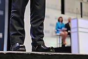 Republican presidential candidate Gov. Scott Walker wears Harley Davidson biker boots as he speaks at the Heritage Foundation Take Back America candidate forum September 18, 2015 in Greenville, South Carolina. The event features 11 presidential candidates but Trump unexpectedly cancelled at the last minute.