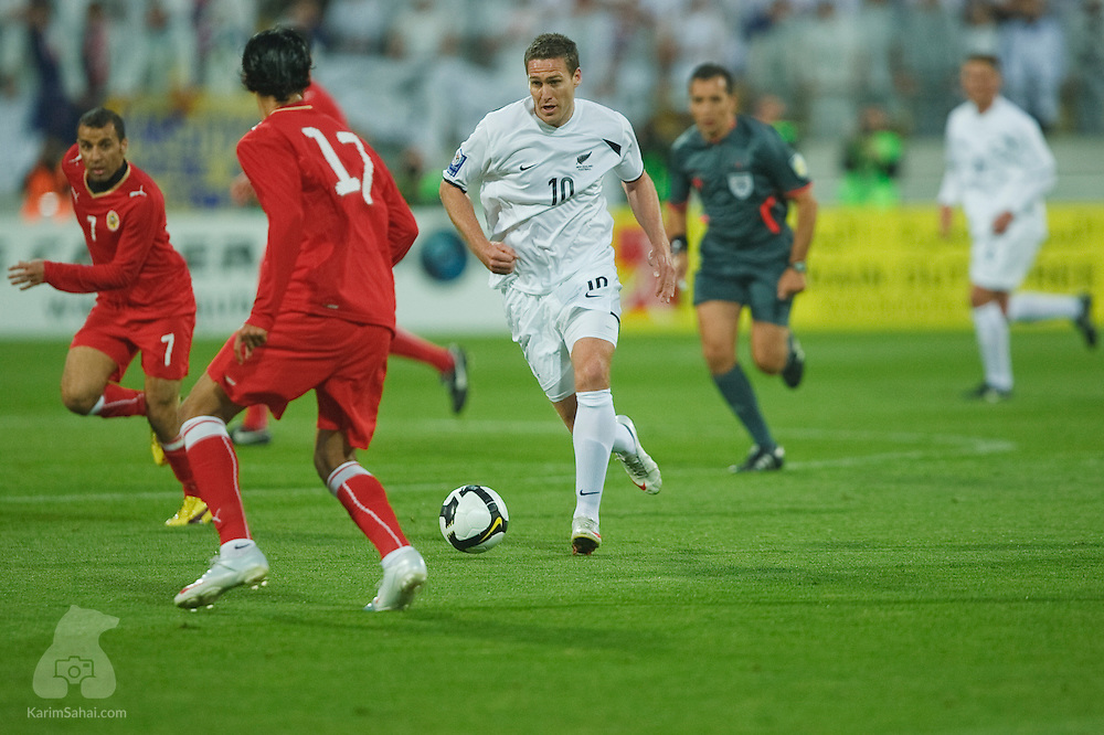 New Zealand All Whites forward Chris Killen runs with the ball with Sayed Mohamed Jalal (L) and Husain Ali Hasan Ali of Bahrain nearby, during the second leg of the 2010 FIFA World Cup qualifying game in front a record 35,194 football fans at Westpac Stadium on November 14, 2009. New Zealand beat Bahrain 1-0 and secured a spot at the 2010 World Cup in South Africa.