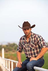 cowboy on a ranch fence