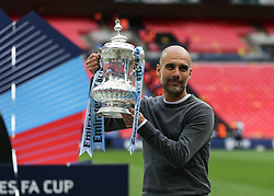 mManchester City manager Pep Guardiola with the FA Cup trophy - Mandatory by-line: Arron Gent/JMP - 18/05/2019 - FOOTBALL - Wembley Stadium - London, England - Manchester City v Watford - Emirates FA Cup Final
