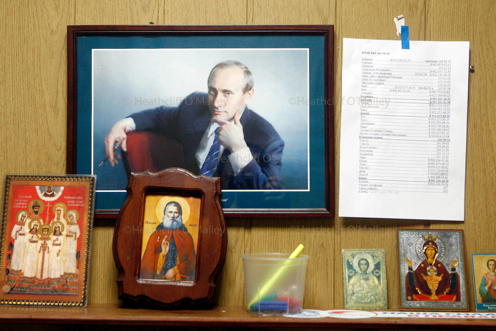 """Photo by Heathcliff Omalley..Yekaterinburg 7 November 2007.Portrait of Russian President Vladimir Putin and Russian Orthodox paraphernalia at the  """"Clinic of the Yekaterinburg City without Drugs"""" founded  by Yevgeny Roizman, suspected ex-Russian Mafia and member of the Duma (Parliament) , where addicts are handcuffed to their beds for the first 27 days of their rehabilitation..Yekaterinburg was the site of the slaughter by Bolsheviks revolutionaries of the Tsar Nicholas and his family in 1918 and in the 1990's suffered from open Mafia warfare on it's streets but is now a thriving city once again."""