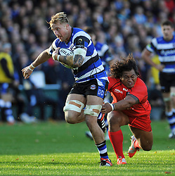 Dominic Day of Bath Rugby takes on the Toulouse defence - Photo mandatory by-line: Patrick Khachfe/JMP - Mobile: 07966 386802 25/10/2014 - SPORT - RUGBY UNION - Bath - The Recreation Ground - Bath Rugby v Toulouse - European Rugby Champions Cup