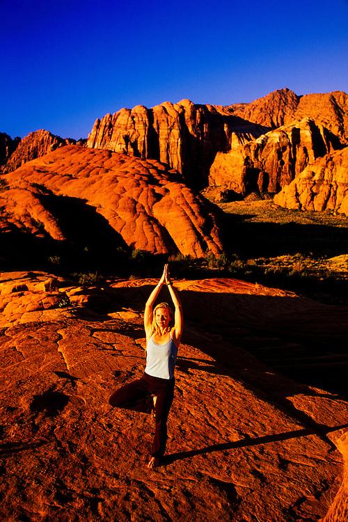 Woman doing yoga, Snow Canyon State Park, near Ivins, Utah