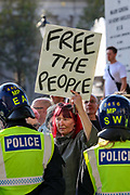 "A protestor holds a placard during a ""Resist and Act for Freedom"" protest against a mandatory coronavirus vaccine, wearing masks, social distancing and a second lockdown, nearby Canada House in Trafalgar Square, London on Saturday, Sept. 19, 2020. The event, which began at noon, drew a broad coalition including coronavirus sceptics, 5G conspiracy theorists and so-called ""anti-vaxxers"". Speakers at the event accused the government of attempting to curtail civil liberties. (VXP Photo/ Vudi Xhymshiti)"