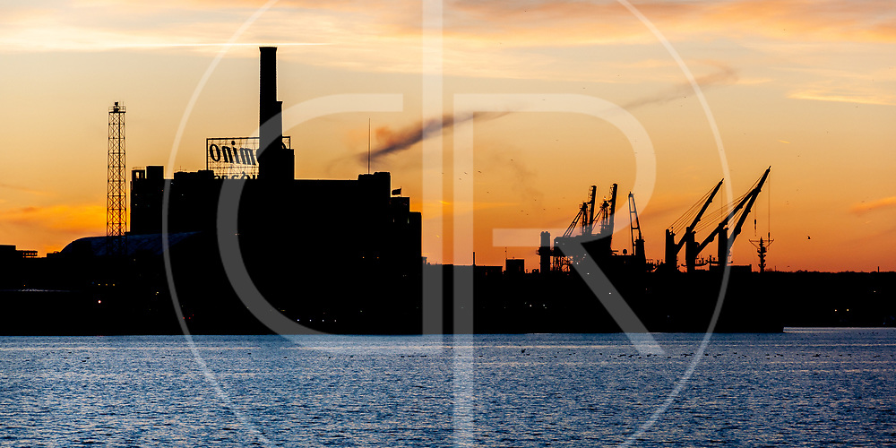 The sun sets on the Domino Sugar Refinery in Baltimore, MD