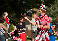 """A festive """"red, white and blue"""" marcher in Laconia's 4th of July parade on Tuesday.  (Karen Bobotas/for the Laconia Daily Sun)"""