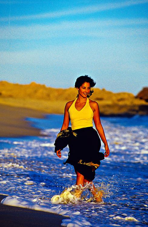 Mexican woman walking on the beach, Hotel Hacienda del Mar, Los Cabos, Baja California, Mexico