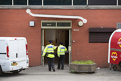 © Licensed to London News Pictures . 15/06/2019. Oldham , UK . Police outside a Pakistani Community Centre in Glodwick , where a fight broke out during a boxing match last night (14th June 2019) . Photo credit : Joel Goodman/LNP