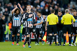 Jack Colback of Newcastle United holds his hand accross his club crest after Newcastle win 2-1 to inflict a first defeat in all competitions this season on Chelsea - Photo mandatory by-line: Rogan Thomson/JMP - 07966 386802 -06/12/2014 - SPORT - FOOTBALL - Newcastle, England - St James' Park - Newcastle United v Chelsea - Barclays Premier League.