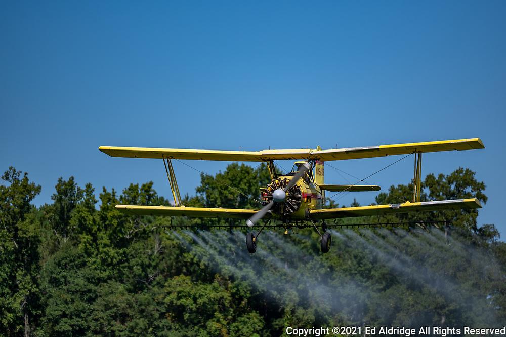 Crop duster spraying fields in rural South Carolina in a bi-plane. Image taken by Ed Aldridge with a NIKON Z 6_2 and NIKKOR Z 70-200mm f/2.8 VR S at 200mm, ISO 50, f2.8, 1/2500.