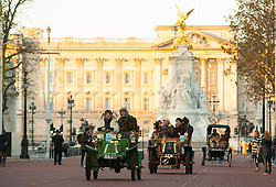 EDITORIAL USE ONLY Participants drive along The Mall, during the Bonhams London to Brighton Veteran Car Run in London.