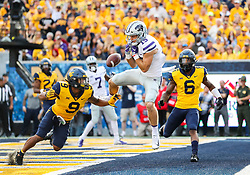 Sep 22, 2018; Morgantown, WV, USA; Kansas State Wildcats wide receiver Zach Reuter (15) drops a pass while defended by West Virginia Mountaineers safety Jovanni Stewart (9) during the third quarter at Mountaineer Field at Milan Puskar Stadium. Mandatory Credit: Ben Queen-USA TODAY Sports
