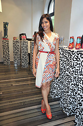FREIDA PINTO at the opening party for Nicholas Kirkwood's new store at 5 Mount Street, London on 12th May 2011.