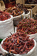 Dried red hot onza, guajillo and cayenne chili pepper at Benito Juarez market in Oaxaca, Mexico.