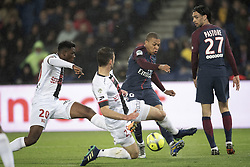 PARIS, April 30, 2018  Kylian Mbappe (2nd R) from Paris Saint-Germain competes with Felix Eboa Eboa (1st L) and Christophe Kerbrat (2nd L) from Guingamp during their match of French Ligue 1 2017-18 season 35th round in Paris, France on April 29, 2018. Paris Saint-Germain equals Guingamp with 2-2 at home. (Credit Image: © Jack Chan/Chine Nouvelle/Xinhua via ZUMA Wire)