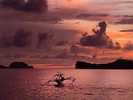 Bangka boat sails at sunset, offshore of San Antonio, Zambales, Luzon Island, Philippines, Southeast Asia, 2016