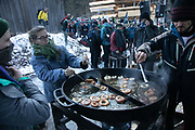 The second day of the Strike WEF march to Davos on 20th of January 2020 in Schiers, Switzerland. Lunch break, as vegan food for 500 people and hot drinks is cooked out doors by a cooking collective. The march started in Schiers and walked the 24 kilomers to Klosters.  The aim is to finish in Davos with a public meeting in the town on the day the WEF begins. The march is a three day protest against the World Economic Forum meeting in Davos. The activists want climate justice and think that The WEF is for the worlds richest and political elite only.