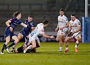 Exeter Chiefs fly-half Joe Simmonds offloads to his brother  No.8 Sam Simmonds during a Gallagher Premiership Round 11 Rugby Union match, Friday, Feb 26, 2021, in Eccles, United Kingdom. (Steve Flynn/Image of Sport)